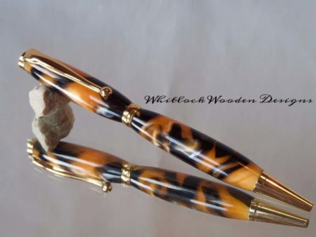 Gold and Black Ball Pen