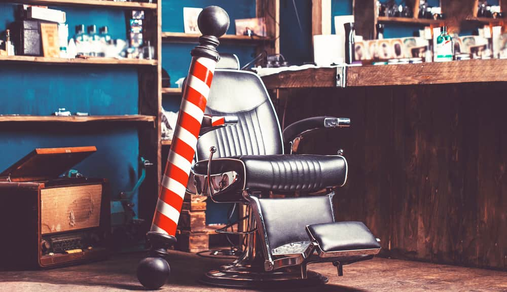 barbers chair and sign